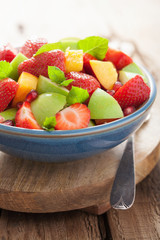 fresh fruit salad with strawberry, apple, nectarine, pomegranate