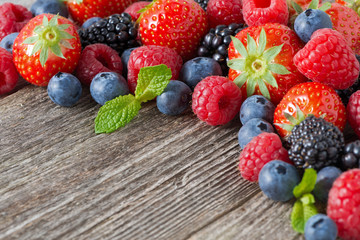wooden background with fresh berries, selective focus