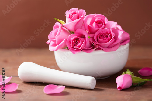 canvas print picture mortar with rose flowers for aromatherapy and spa