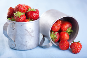 fresh strawberry in rustic cups