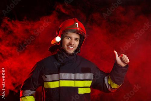 Fireman showing thumb up - 66987639