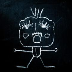 funny figure painted with chalk on a blackboard
