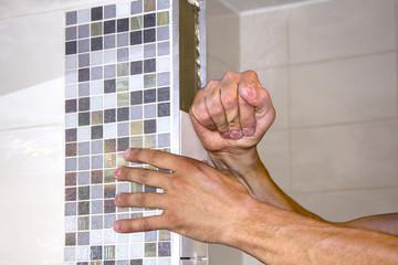 Worker puts tiles