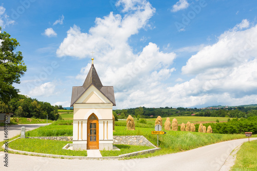 Poster Traditional chapel in Slovenia, Europe.