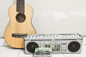 guitar and cassette player