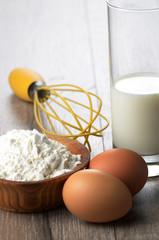 Milk, flour, whisk and eggs