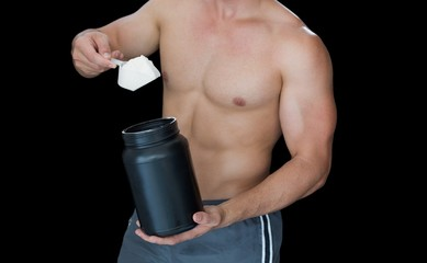 Muscular man scooping up protein powder