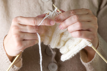 Hands knitting cose-up