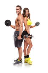 beautiful fitness young sporty couple with dumbbell
