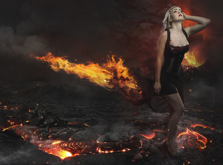 Beautiful blonde in a desolate landscape with a volcano of lava