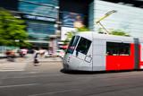 Modern tram blurred in motion in the Prague city, Europe