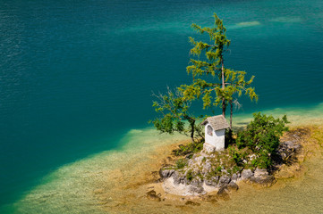 Small island in turquoise Wolfgangsee lake in Austria