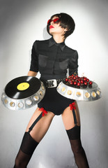 DJ girl with cherries on a plate