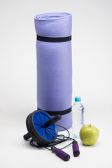 Yoga mat with skipping rope, water bottle, abs roller, measuring
