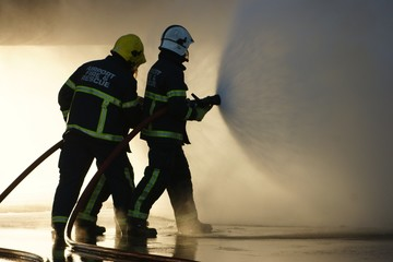 fire fighters with hose