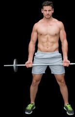 Serious handsome crossfitter lifting up barbell
