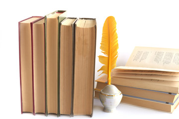 Old books of poetry and quill Pen isolated on white background