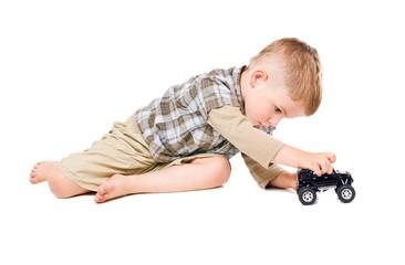 Cute boy playing toy car
