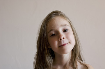 isolated portrait of a posing beautiful young girl
