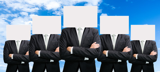 Businessman standing white paper face holding front of head