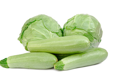 cabbage and vegetable marrows on a white background