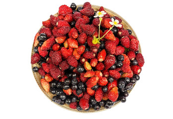 bilberry and wild strawberry in a plate