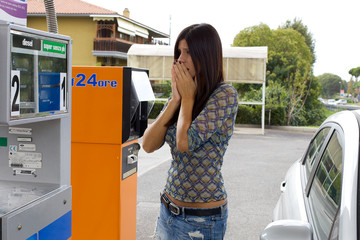 woman scared of price of gas