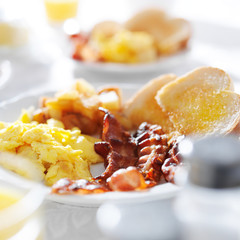 scarmabled eggs and bacon breakfast meal