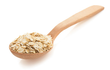 oat flakes in spoon on white