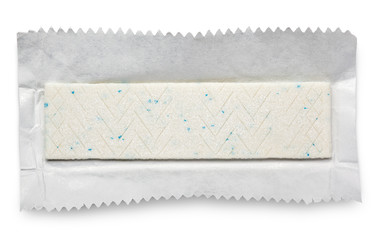 Chewing gum plate on wrapping paper isolated on white