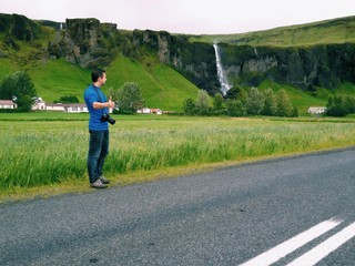 Photographer hitch hiking in south iceland