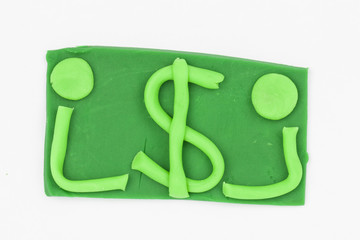 Dollar from children bright plasticine - Stock Image macro.
