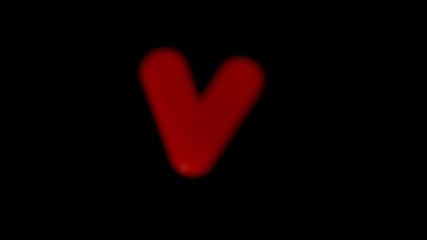 The letter v coming into focus on black background