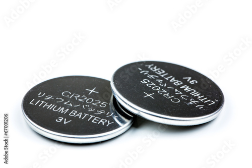 canvas print picture Lithium button cell battery isolated on white
