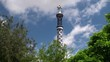 Tower with the cross at the Entrance of Park Guell. Barcelona,