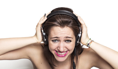 Girl listening to music and grinning