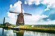 Traditional dutch windmill near the canal