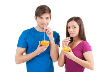 beautiful couple drinking orange juice.