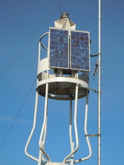 Beacon with solar panels and radar corner reflector