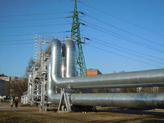 Shining pipes and power transmission tower