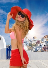 Young woman in red shorts in Santorini