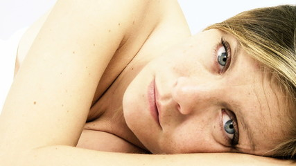 Closeup of beautiful woman falling asleep