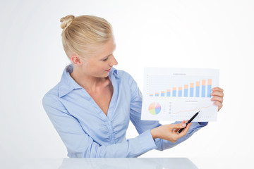 blond business woman pointing a chart with pen