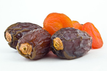 sweet figs and dried apricots on white background