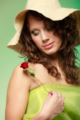 Spring or summer. woman girl in hat holds red rose flower