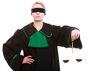 female lawyer attorney in polish gown and scales