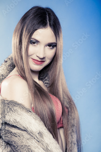 canvas print picture Sexy girl long hair red bra underwear and fur coat on blue