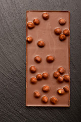 Chocolate with nuts on dark background