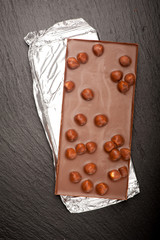 Chocolate with nuts on dark background. Chocolate background