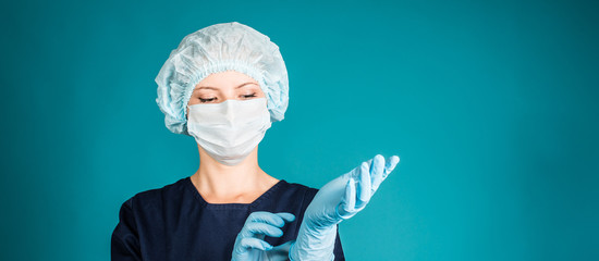 Doctor or nurse wearing surgical mask, cap and putting gloves